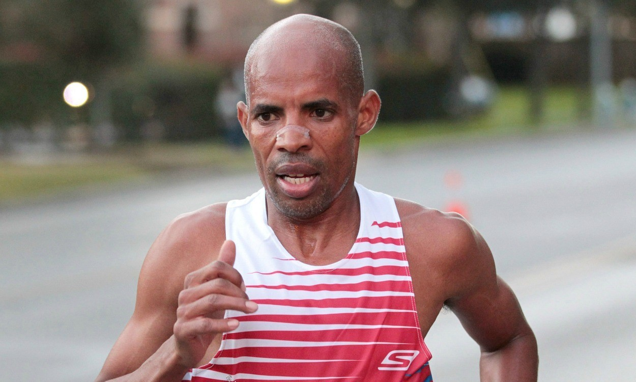 American Keflezighi wins Boston Marathon, as Jeptoo sets course record