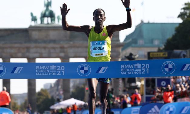 Guye Adola survives savage early pace to win Berlin Marathon